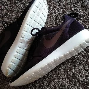 Woman's nikes dark purple